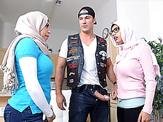 Muslim mother gives a blowjob to the girlfriends scrounger under the table