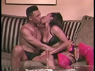 Gorgeous ebony chick in pink latex butler Janet Jacme rides disastrous guy's hard cock in the living room